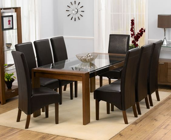 classy formal dining furniture set consisting of black leather coat dining chairs glass top dining table