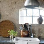 Concrete Walls Without Finish Concrete Countertop With White Farmhouse Sink Oversized Industrial Pendant