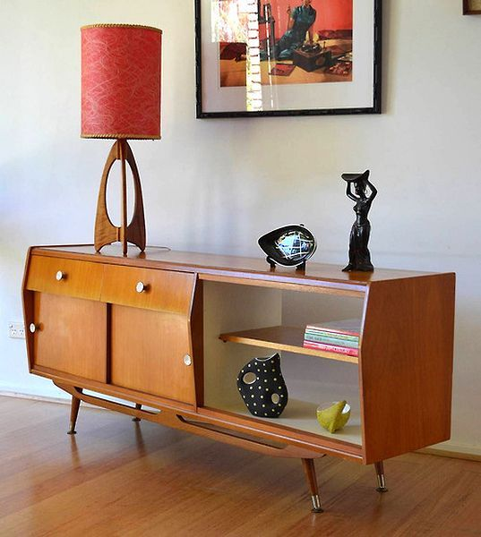 custom made console table with cabinetry drawer system and open shelving units for display