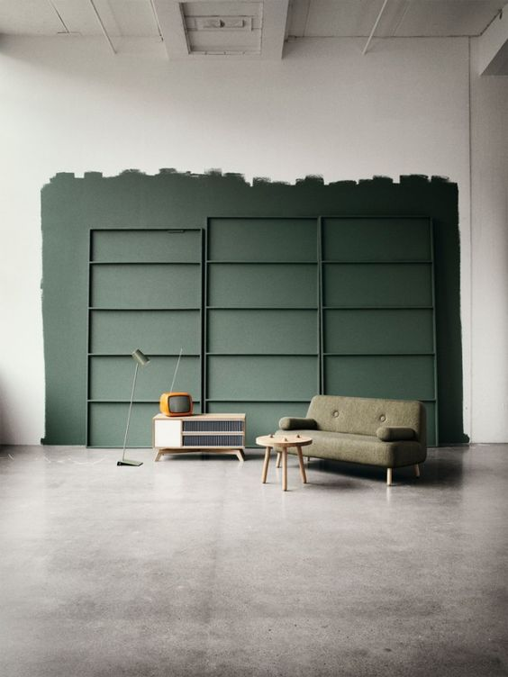 dark green accent wall featuring with crisp white color light green sofa light wood coffee table