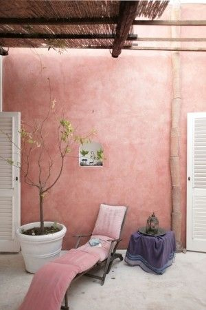 dusty pink walls and reclining chair