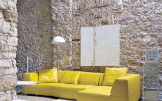 hard textured stoned walls modern minimalist sofa in yellow white area rug