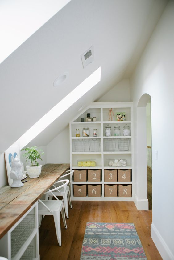 kids study room in attic room custom shelving unit multicolored runner longer wood desk white chairs slanted ceiling with skylight wood floors