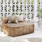 Knitted Dry Seagrass Outdoor Chair With Low Backrest A Couple Of Boho Style Throw Pillows