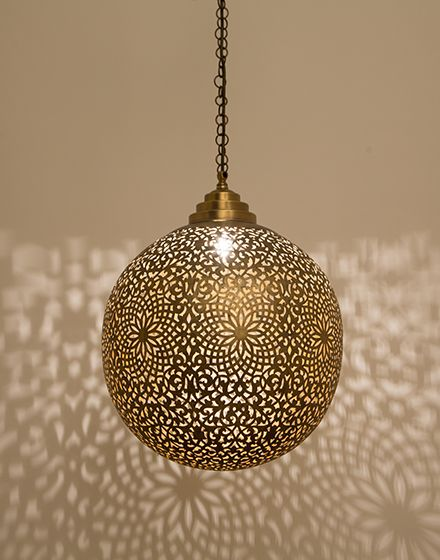 largest Moroccan pendant with brass sheet cover accented with floral motifs