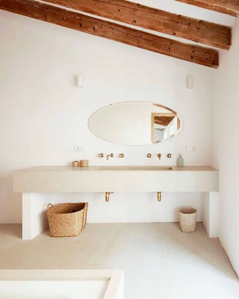light and bright bathroom idea oval shaped mirror without frame concrete bathroom countertop baskets for strorage exposed wood beams