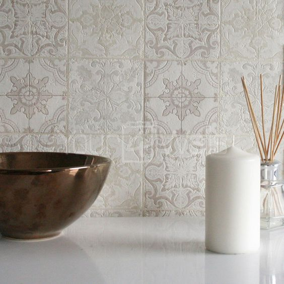 light gray Moroccan tile backsplash with embossed geometric motifs