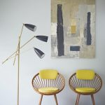 Midcentury Modern Chairs With Yellow Cushion Pad On Seat And Backrest Modern Floor Lamp With Black Lampshade Abstract Painting As Wall Ornament