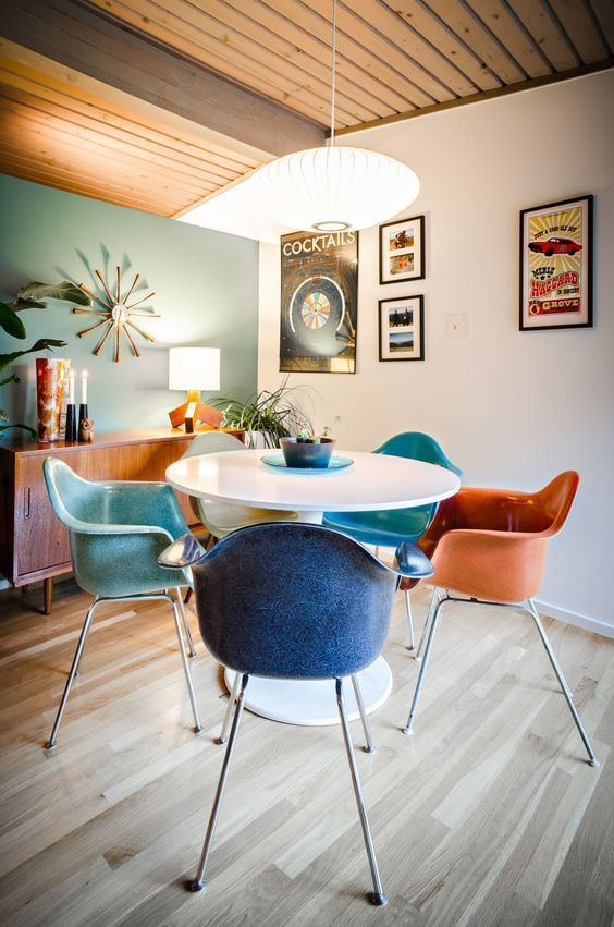 midcentury modern dining chairs in pop of colors round shaped dining table in white
