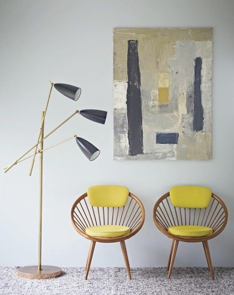 midcentury modern egg chairs with yellow cushion addition modern floor lamp with triple lampshade abstract wall decor