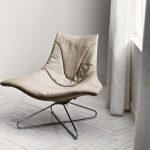 Modern Chair With Crossed Hairpin Like Legs Open And Wide Scoop And Sloper Back Rest