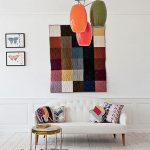 Modern Elegant White Loveseat With Tufted Upholstery Colorful Pendants Colorful Wall Decor Colorful Wool Area Rug
