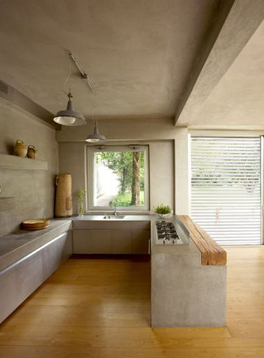 modern industrial kitchen idea bare concrete walls ceilings and kitchen station wood floors wood bar table