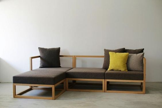 modern rustic sofa with wood frame and dark gray cushion plus additional chaise