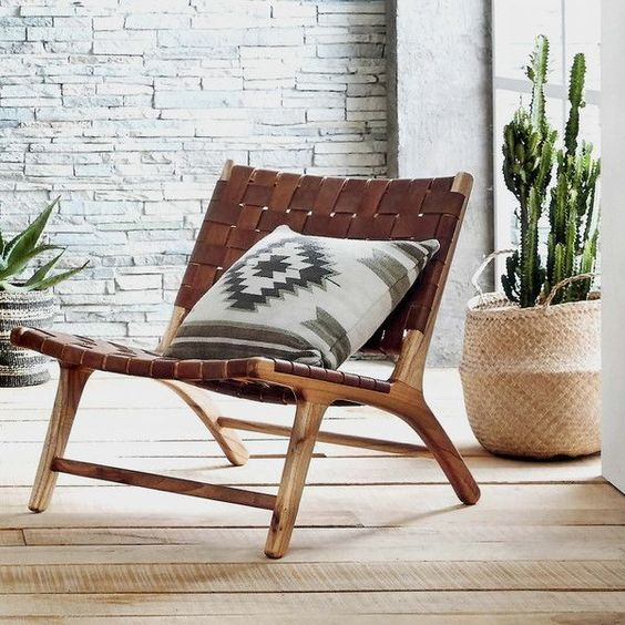 modern scoop and open weave design lounge chair with leather band joins on back and seater