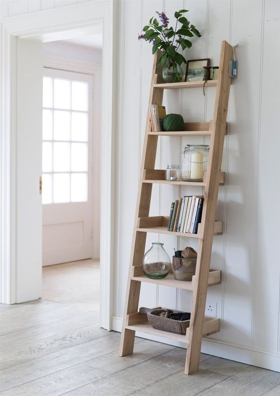 oak leaning ladder as book and photos display