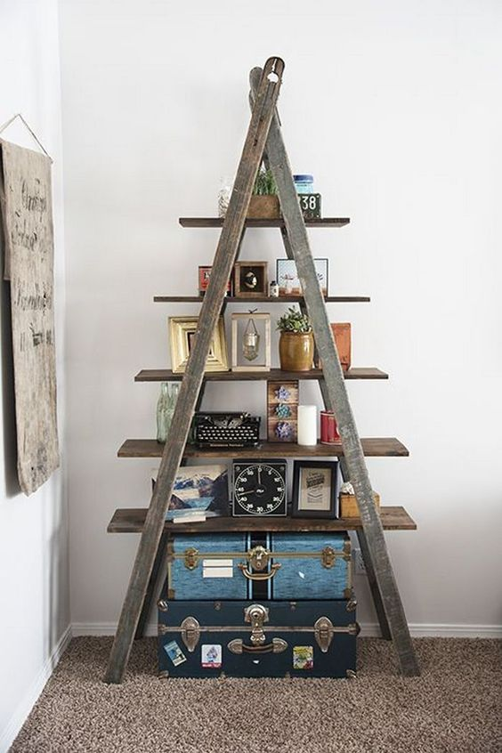 old dark wood ladder as the ornate display rack