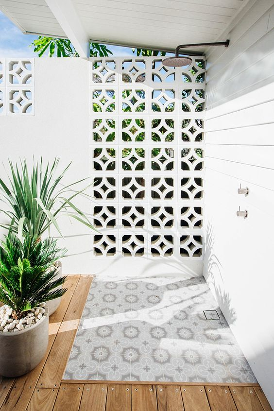 outdoor shower space with geometric shaped air ventilator as well as room separator
