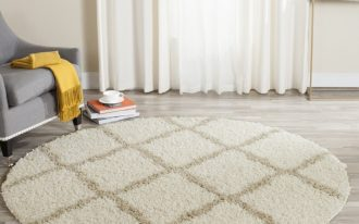 round shaped wool area rug with stripe accents