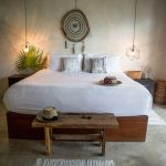 Rustic Industrial Bedroom Design Bare Concrete Walls And Floors Industrial Style Pendants Hardwood Bed Frame White Bedding Treatment Small Mat Large Size Dream Catcher Wall Decor