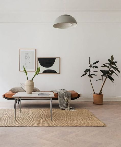 rustic minimalist living room idea midcentury modern bench seat with cushion modern white coffee table textured woven area rug potted houseplant some wall decors oversized pendant with white lampshade