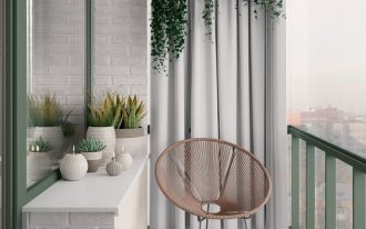 small balcony hanging potted greenery with curtains as the dramatic background light tone vintage rug egg shaped wicker chair white throw pillow