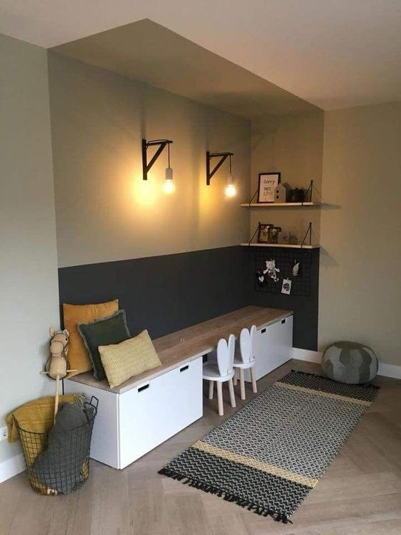 study room for kids longer table roled as bench seat a couple of chairs runner with tassels industrial lighting fixtures