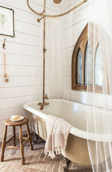 timeless bathroom design vintage claw foot bathtub brass finish bathroom utensils semi transparent showering curtains wood stool