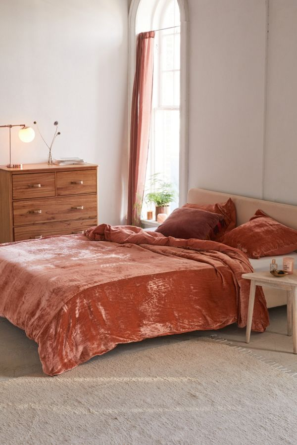 velvet duvet cover in terracotta wooden dresser light wood bed frame with headboard light wood side table