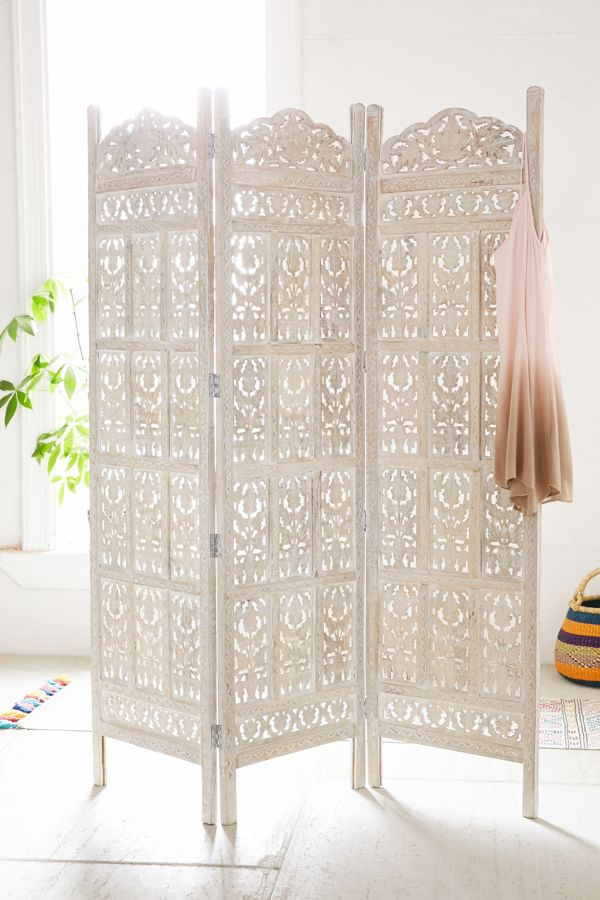 white carved screen made of wood