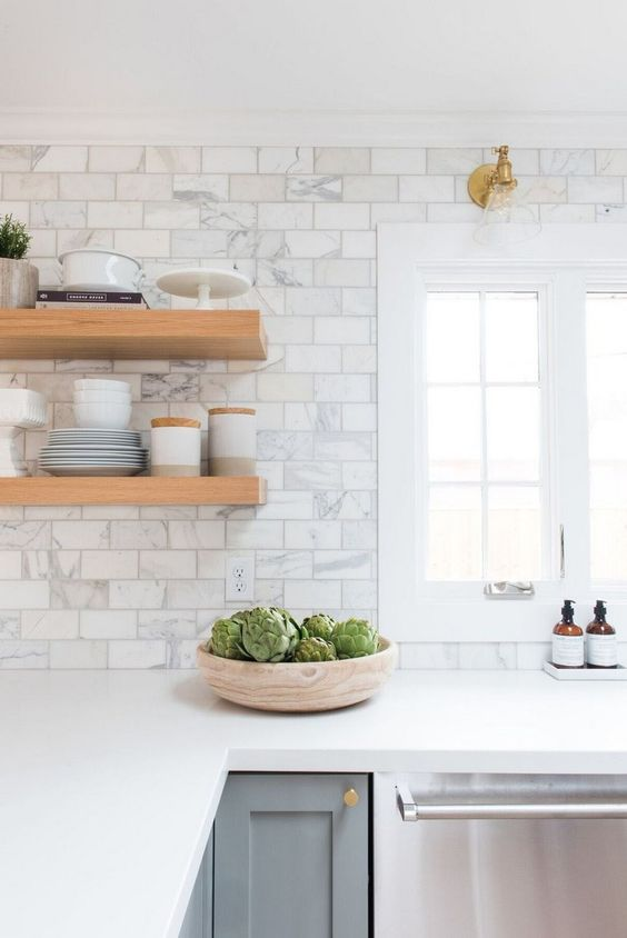 white kitchen design wooden open shelves gray kitchen cabinetry white subway tile backsplash with stains white countertop