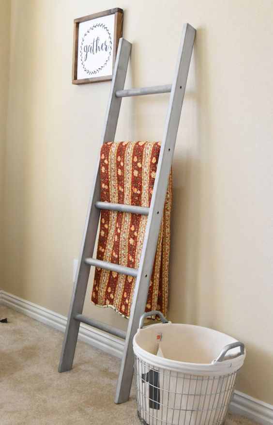 white painted leaning ladder as vintage throw blanket display