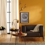 Yellow Color Wall Idea Modern Black Leather Sofa With Throw Blanket Wood Top Side Table Brass Finish Table Lamp White Window Curtains Gray Area Rug