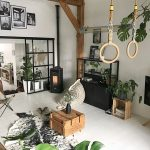 Industrial Scandinavian Living Room Design White Finished Wood Plank Floors White Walls Crate Coffee Table Cowhide Rug Black Finish Window Trims And Furniture