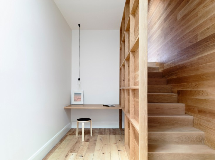 Scandinavian home office next to stairs floating workdesk stool with black top hanging lamp