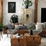 A Couple Of Crate Coffee Tables Midcentury Modern Sofa In Earthy Brown Color Gray Throw Pillows And Throw Blankets Some Potted Greenery