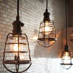 Aged Pendant Lighting With Durable Bronze Cage And Vintage Bulb