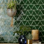 Bold Green Tiled Backsplash In Triangle Patterns And White Grouts Hanging Decorative Plant Some Potted Plants