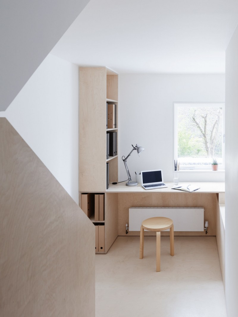 bright and airy home office white walls light wood working desk light wood stool light wood racks glass window