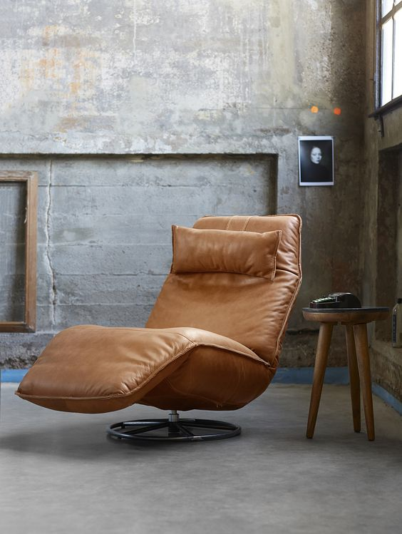 brown leather lounge chair with headrest and footrest midcentury modern wood side table with round top