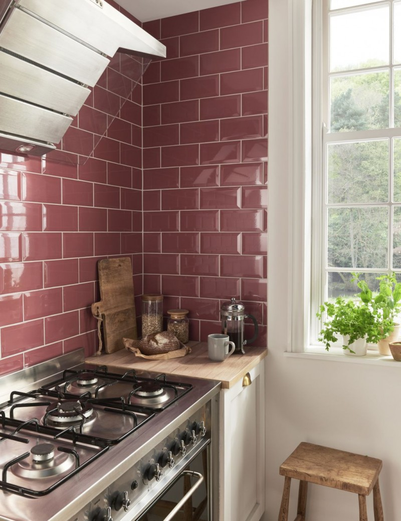deep red metro tiled backsplash in small kitchen