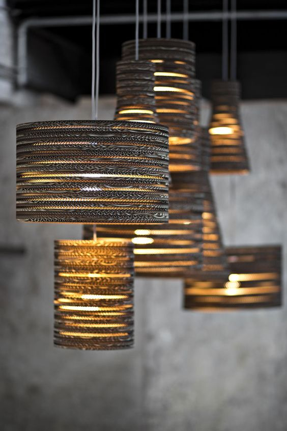 golden pendants with textured metal lampshades