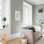 Gray Wall Color Featuring White Trims And Baseboard Soft Gray Covered Sofa Wood Plank Floors
