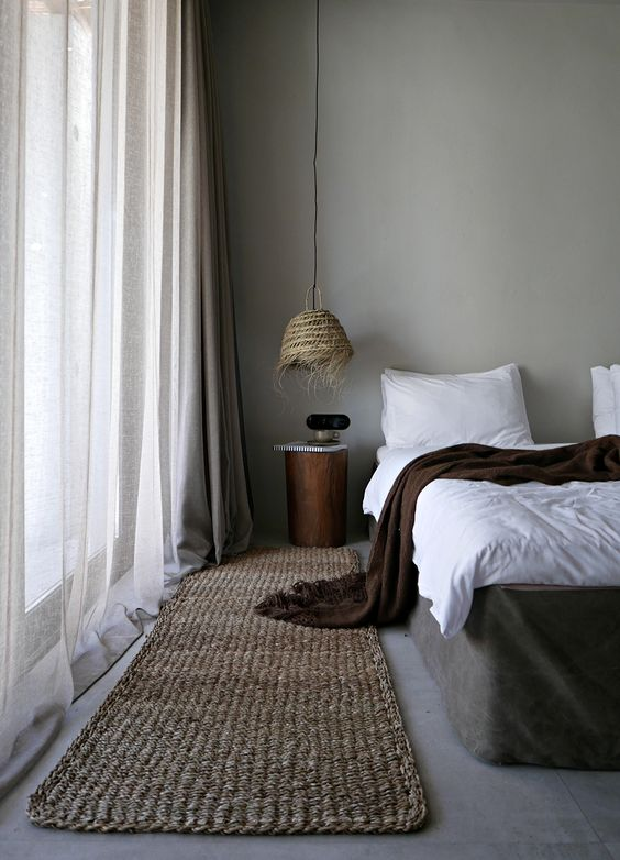 gray wall paint color white duvet cover and shams dark brown throw blanket woven runner dramatic white curtains woven hanging lamp log bedside table
