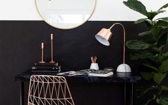 half way black half way white wall black working desk copper working chair copper framed wall mirror in round shape copper finish table lamp
