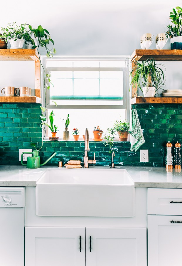 kitchen design Marrs Green tiled backsplash white kitchen cabinets white countertop farmhouse sink wood open shelves with potted greenery