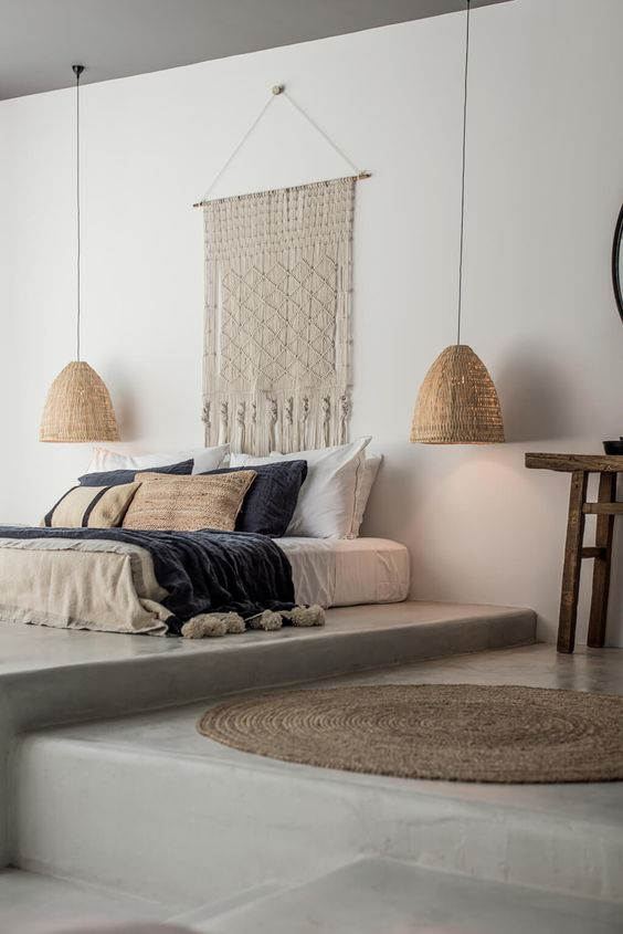 macrame wall decor a couple of long wired ceiling lamps round shaped crochet rug
