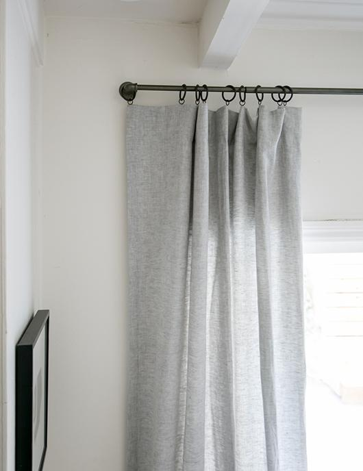metal hardware of curtains in dark finish ultra light gray draperies