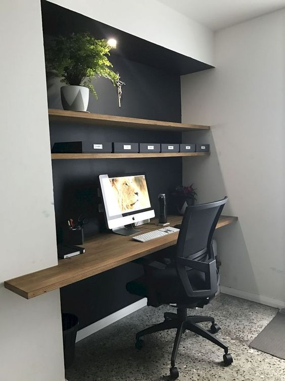 modern workspace in black furnished with wood open shelves and working desk movable working chair in black
