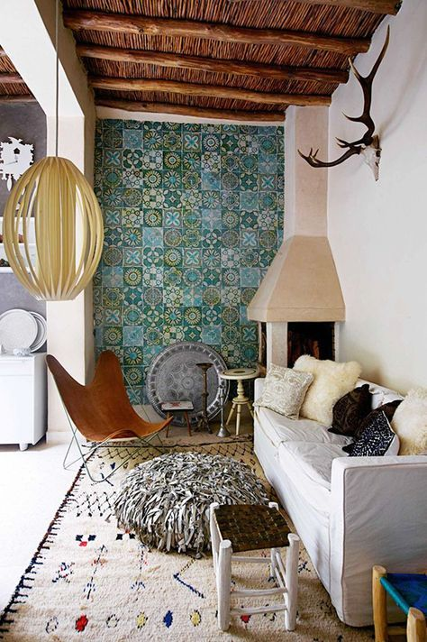 multi pattern tile walls linen area rug with ethnic motifs white sofa slipcover fringed floor pillow in gray tiny side table